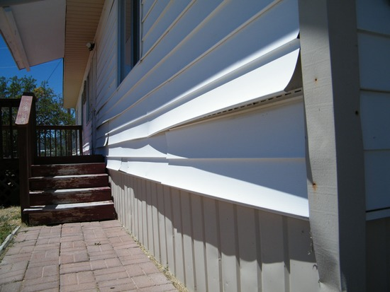 damaged vinyl siding kansas city